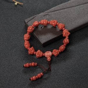 MOMO橘红珊瑚佛头手串