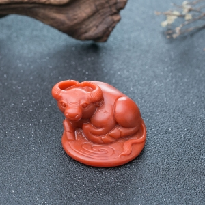柿子红南红丑牛摆件