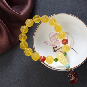 11mm鸡油黄金绞蜜回纹珠单圈手串