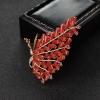 金镶钻阿卡朱红珊瑚凤凰胸针-红掌柜